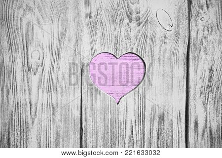White heart carved in a wooden board. Background
