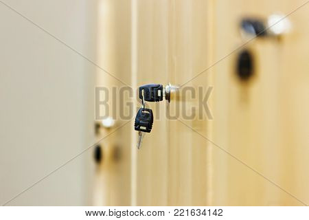 view of a wooden key locker with black key