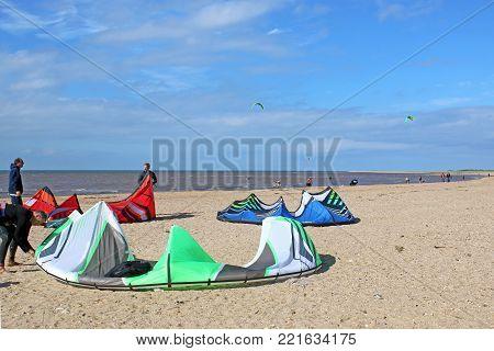 kitesurfers preparing their kites on Old Hunstanton beach