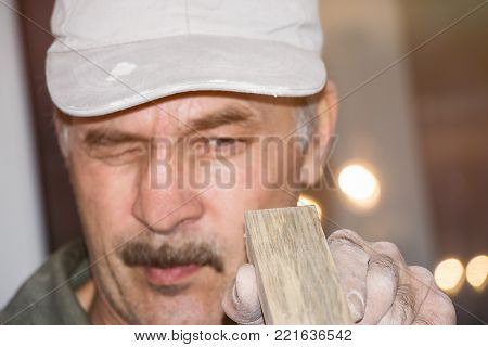 The carpenter checks the Board. Selective focus