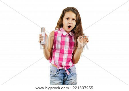 A cute little girl in the form of a glamorous diva with comb and eau de toilette - isolated on white background. Funny picture