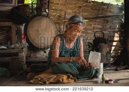 Asia old woman living in the countryside .The way of life of rural people in Thailand.