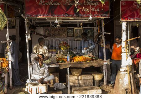 DELHI, INDIA - December 10 2014 :  flower garland shop at chandni chowk in old delhi. this flower garland for worship at hinduism temple