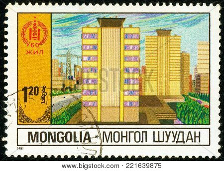 Ukraine - circa 2018: A postage stamp printed in Mongolia shows Multi-storey residential buildings. Public housing. Series: 60 Years of Independence. Circa 1981