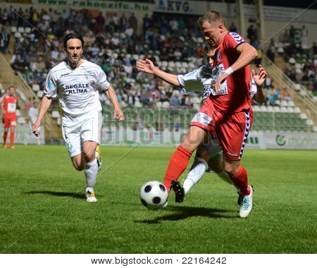 KAPOSVAR, HUNGARY - MAY 14: Lorant Olah (L) in action at a Hungarian National Championship soccer game - Kaposvar vs Szolnok on May 14, 2011 in Kaposvar, Hungary.