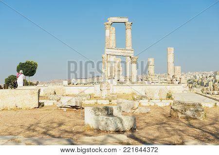 AMMAN, JORDAN - AUGUST 18, 2012: View to the ancient stone columns at the Citadel of Amman in Amman, Jordan.