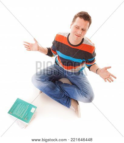 Exhausted tired college student with pile of books studying for exams isolated on white background