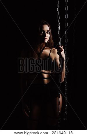 Portrait of young girl blonde European appearance in chains