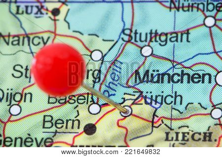 Close-up of a red pushpin in a map of Zurich (Zürich), Switzerland.