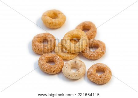 Closeup Of A Few Round Breakfast Cereals Isolated On White Background.