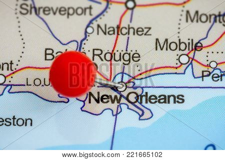 Close-up of a red pushpin on a map of New Orleans, USA.