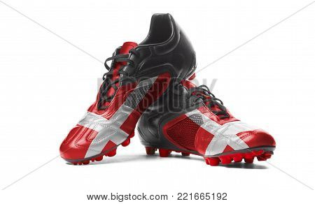 The Danish flag painted on football boots. Isolated on white background.