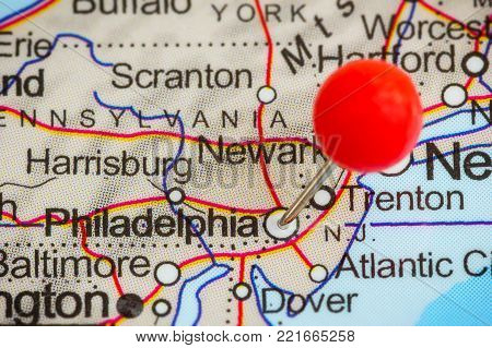 Close-up of a red pushpin on a map of Philadelphia, USA.