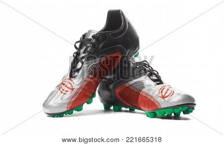 The Iranian flag painted on football boots. Isolated on white background.