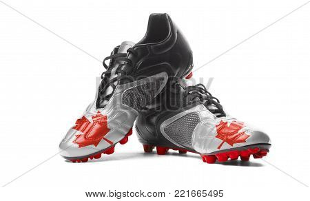 The Canadian flag painted on football boots. Isolated on white background.