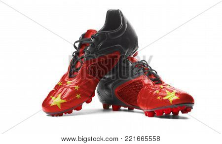 The Chinese flag painted on football boots. Isolated on white background.