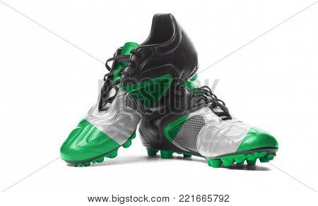 The Nigerian flag painted on football boots. Isolated on white background.
