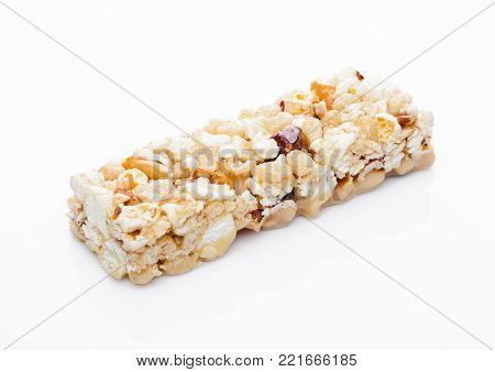 Popcorn Caramel protein cereal energy bar with nuts on white background