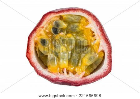 Close-up of a sliced passion fruit (passionfruit, purple granadilla (Passiflora edulis)) viewed from the front, isolated on white background.