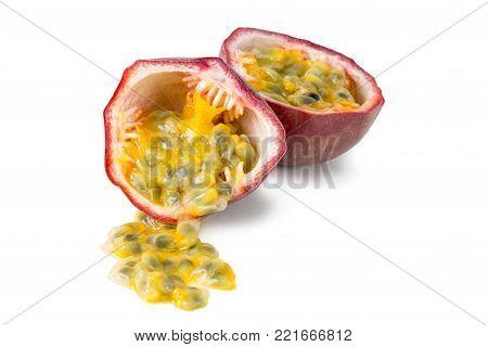 Close-up of a split passion fruit (passionfruit, purple granadilla (Passiflora edulis)) isolated on white background.