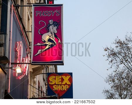 PARIS, FRANCE - DECEMBER 19, 2017: Sex Shop lights and front stores in the red light district of Paris, Pigalle. Quartier Pigalle is famous for being a tourist district, with many sex shops, theatres and adult shows