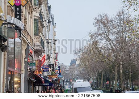 PARIS, FRANCE - DECEMBER 19, 2017: View of Boulevard de Clich in northern Paris, in Pigalle district. Quartier Pigalle is famous for being a tourist district, with many sex shops, theatres and adult shows