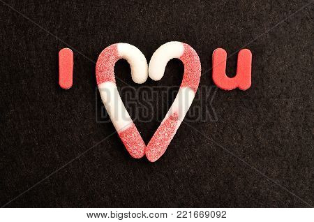 I love you. The love is replaced with candy canes in the shape of a heart