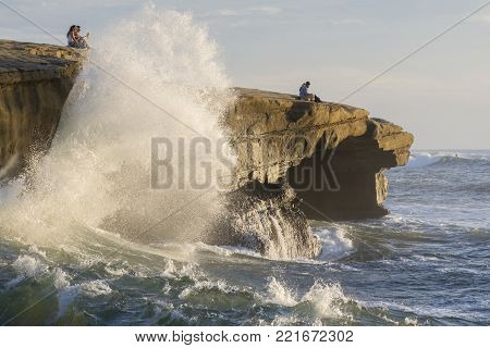 SAN DIEGO, CALIFORNIA, USA - OCTOBER 17, 2017: Sunset Cliffs is a popular destination for romantic couples to watch the sunset as well as the thrilling experience of waves crashing against the cliffs