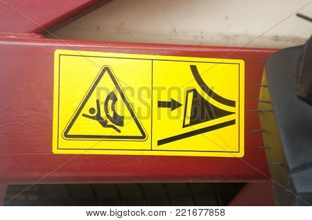 Warning sign on agricultural machinery. Before installing the machine in the parking lot, special platforms should be installed support.