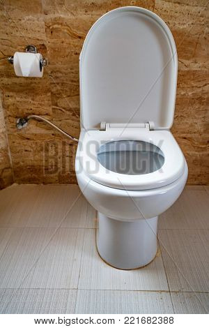 Modern flush toilet bowl at WC or water closet