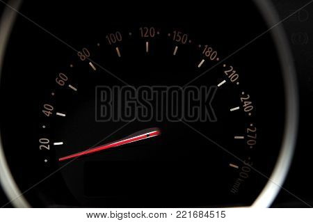 Car speedometer with black background and white digits.