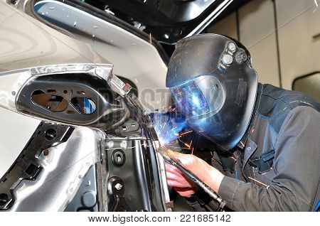 Proffesional car body repair, welding car panels.
