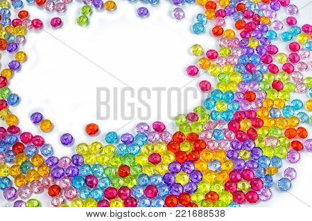 acrylic beads on a white background. Acrylic beads for design. Top view with copy space for your text