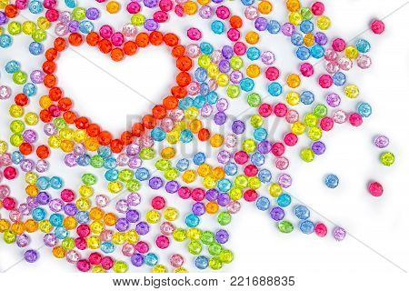acrylic beads on a white background. Acrylic beads for design.Top view with copy space for your text
