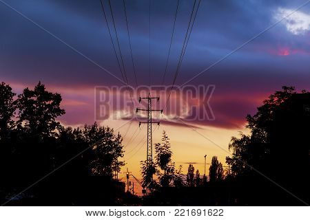 Power-lines silhouetted by sky at sunset The silhouette of the evening electricity transmission