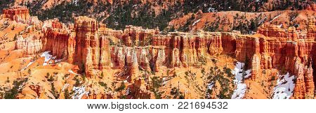 The colorful red and orange hoodoos of Bryce Canyon National Park in Utah rise majestically from the valley