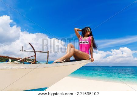 Young Beautiful Brunette With Hair Flying In The Wind Having Fun On A Tropical Beach. Summer Vacatio