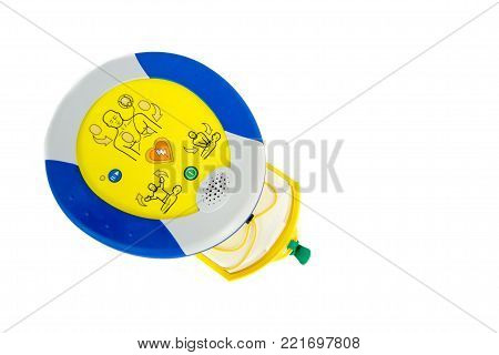 Automated external defibrillator or AED with pads compartiment open, isolated on white.