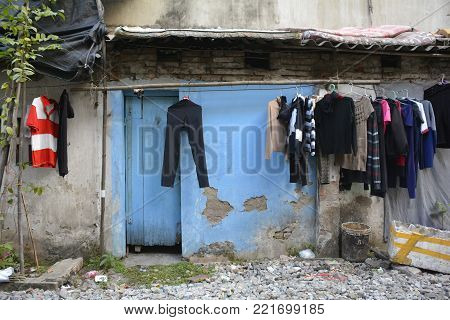 Washing hangs outside a small house down a back alley in the old quarter of Hanoi, Vietnam
