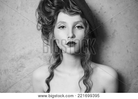 Black and white art monochrome photography. Black and white creative photography. Black and white conceptual image. Beautiful black and white background. Black and white portrait. Girl with pale skin and a bright unusual appearance with a beret on her hea