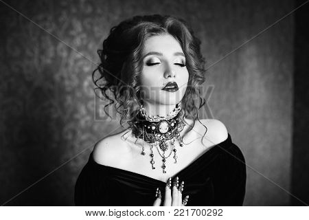 Black and white art monochrome photography. Black and white creative photography. Black and white conceptual image. Beautiful black and white background. Black and white portrait. A woman is a vampire with pale skin in a black dress.