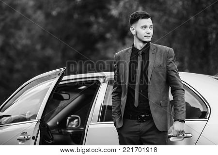 Black and white art monochrome photography. Black and white creative photography. Black and white conceptual image. Beautiful black and white background. Black and white portrait. Successful businessman in a dark business suit