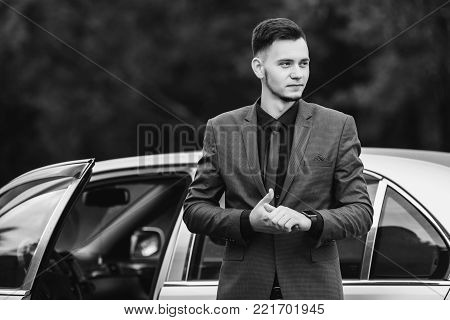 Black and white art monochrome photography. Black and white creative photography. Black and white conceptual image. Beautiful black and white background. Black and white portrait.Successful businessman in a dark business suit