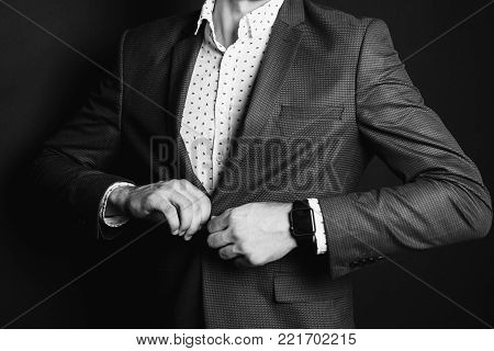 A successful young businessman in a business suit. Black and white art monochrome photography. Black and white creative photography. Black and white conceptual image. Beautiful black and white background. Black and white portrait.