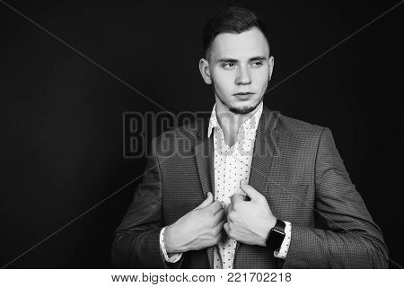 Black and white art monochrome photography. Black and white creative photography. Black and white conceptual image. Beautiful black and white background. Black and white portrait. Successful young businessman in business suit