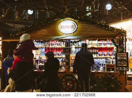 STRASBOURG, FRANCE - DEC 23, 2016: Christmas Market stall chalet selling multiple types of alcoholic beverages predominantly beer from the Meteor Brand