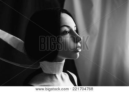 Emotional portrait of brunette girl with long straight black hair. Black and white art monochrome photography. Black and white creative photography. Black and white conceptual image. Beautiful black and white background. Black and white portrait.
