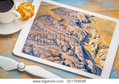 Main Draw OHV Area in Pawnee National Grasslland in northern Colorado, fall or winter scenery, reviewing an aerial image on a digital tablet