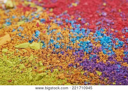 Surface coated with the colorful paint pigment, shallow depth of field composition