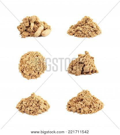 Pile of crushed and crumbled turkish halva confection, composition isolated over the white background, set of six different foreshortenings